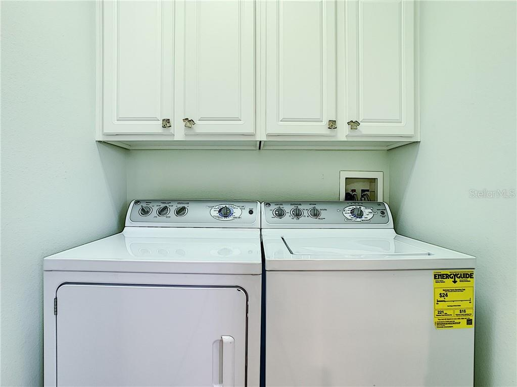 Laundry room with storage cabinets. - Condo for sale at 9453 Discovery Ter #201c, Bradenton, FL 34212 - MLS Number is A4423314
