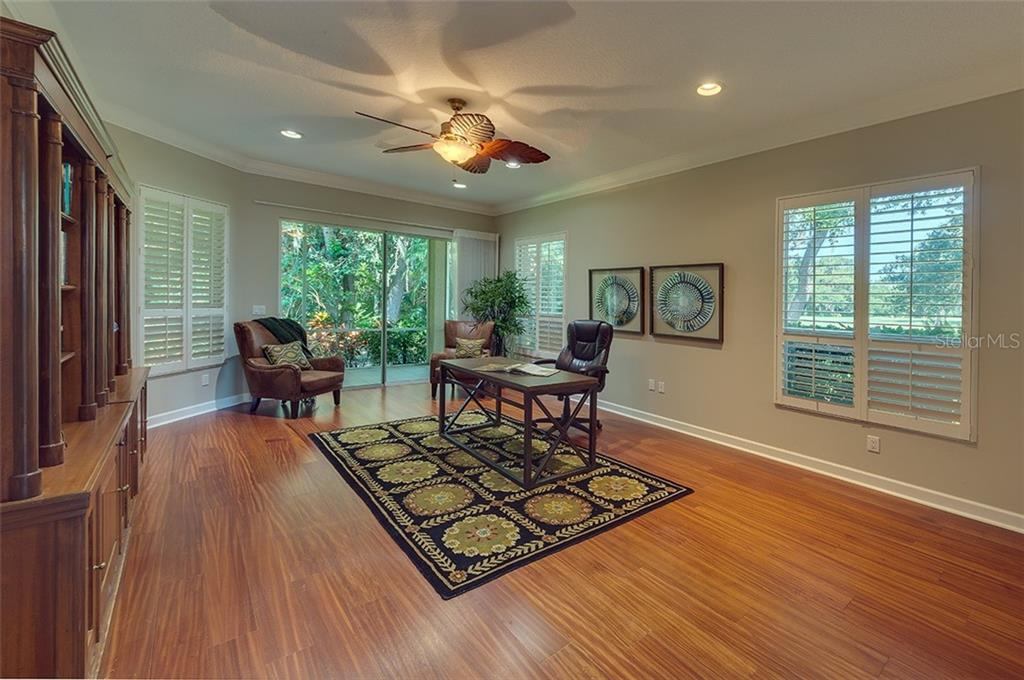Beautiful den with wood flooring, sliders leading to the back lanai.  This den has a spacious closet so can be used as an extra bedroom. - Single Family Home for sale at 2972 Jeff Myers Cir, Sarasota, FL 34240 - MLS Number is A4424133