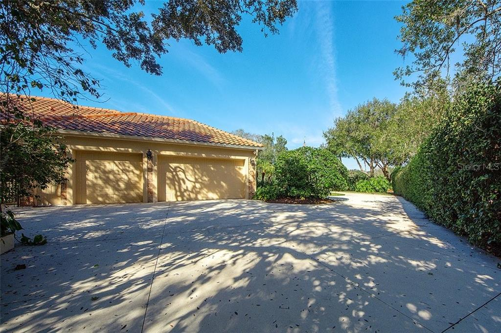 Oversized 3-car garage and extra storage room. - Single Family Home for sale at 2972 Jeff Myers Cir, Sarasota, FL 34240 - MLS Number is A4424133