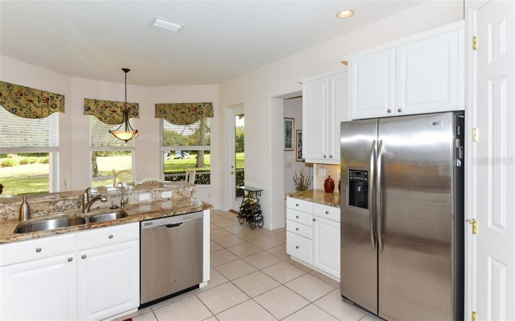 Eat in kitchen with a view of the golf course! - Single Family Home for sale at 8473 Eagle Preserve Way, Sarasota, FL 34241 - MLS Number is A4425945