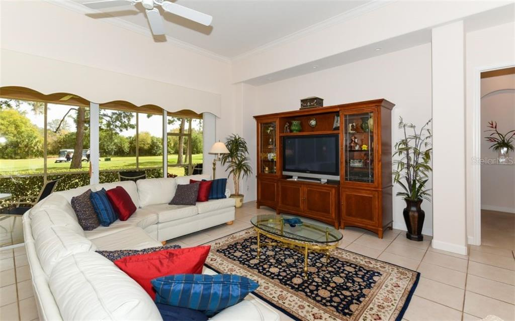 Large living room with a golf course view! - Single Family Home for sale at 8473 Eagle Preserve Way, Sarasota, FL 34241 - MLS Number is A4425945