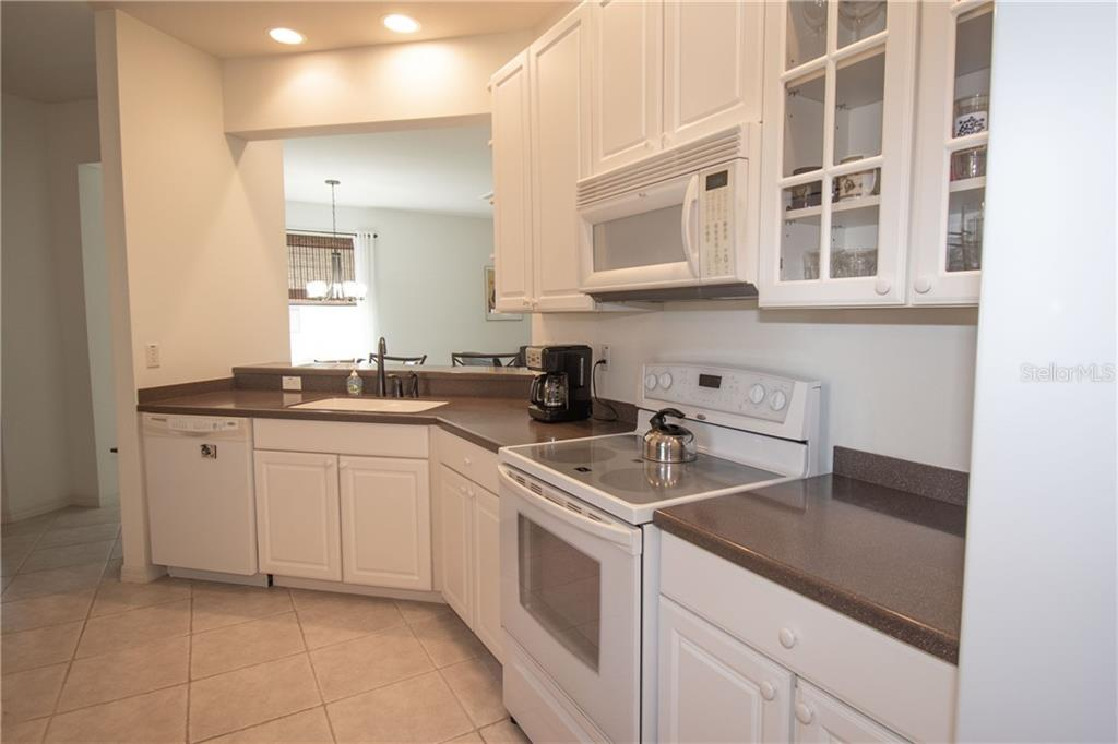 Large Kitchen with Corian Counter tops - Villa for sale at 1808 Batello Dr, Venice, FL 34292 - MLS Number is A4426491