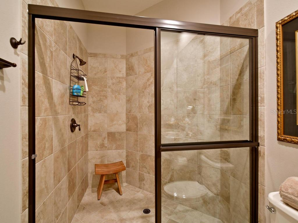 3rd bedroom's ensuite bathroom, what a HUGE shower! - Single Family Home for sale at 13707 Palazzo Ter, Bradenton, FL 34211 - MLS Number is A4427731