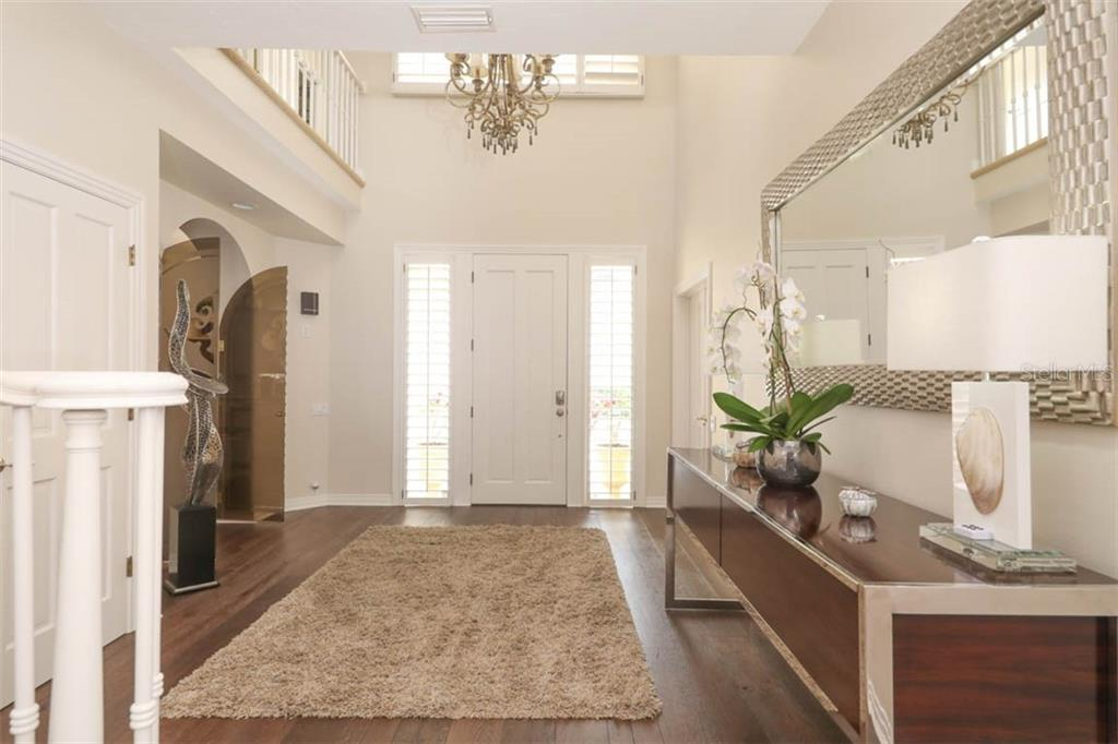 Foyer - Single Family Home for sale at 7728 Club Ln, Sarasota, FL 34238 - MLS Number is A4428061