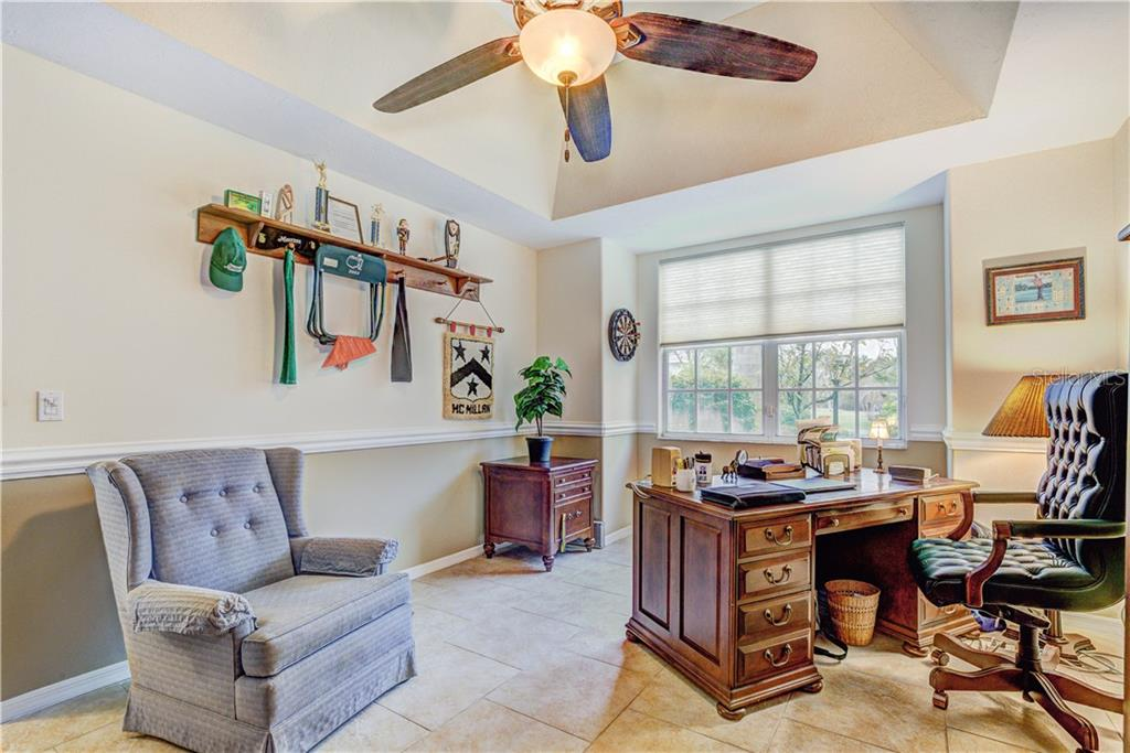 This huge study has tray ceiling and three toned paint - Single Family Home for sale at 6321 W Glen Abbey Ln E, Bradenton, FL 34202 - MLS Number is A4429610