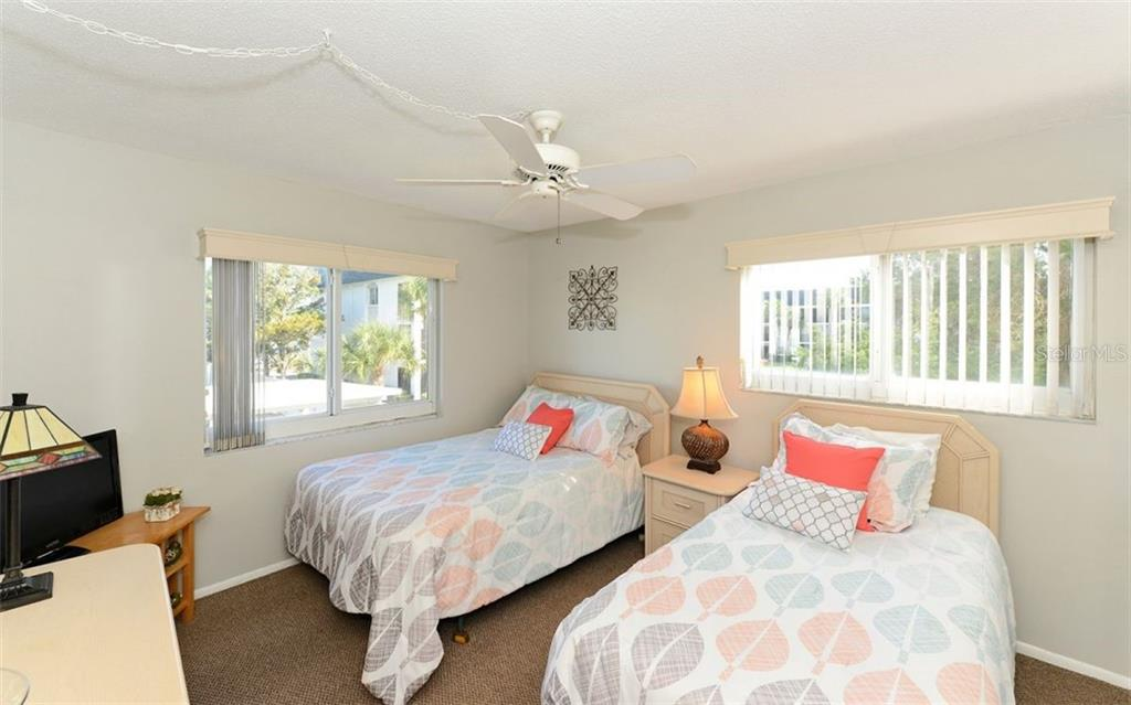 Guest Bedroom. - Condo for sale at 797 Beach Rd #215, Sarasota, FL 34242 - MLS Number is A4430524