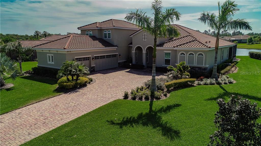 Lake front living in a quiet location, yet close to shopping and great schools. - Single Family Home for sale at 17006 1st Dr E, Bradenton, FL 34212 - MLS Number is A4432830
