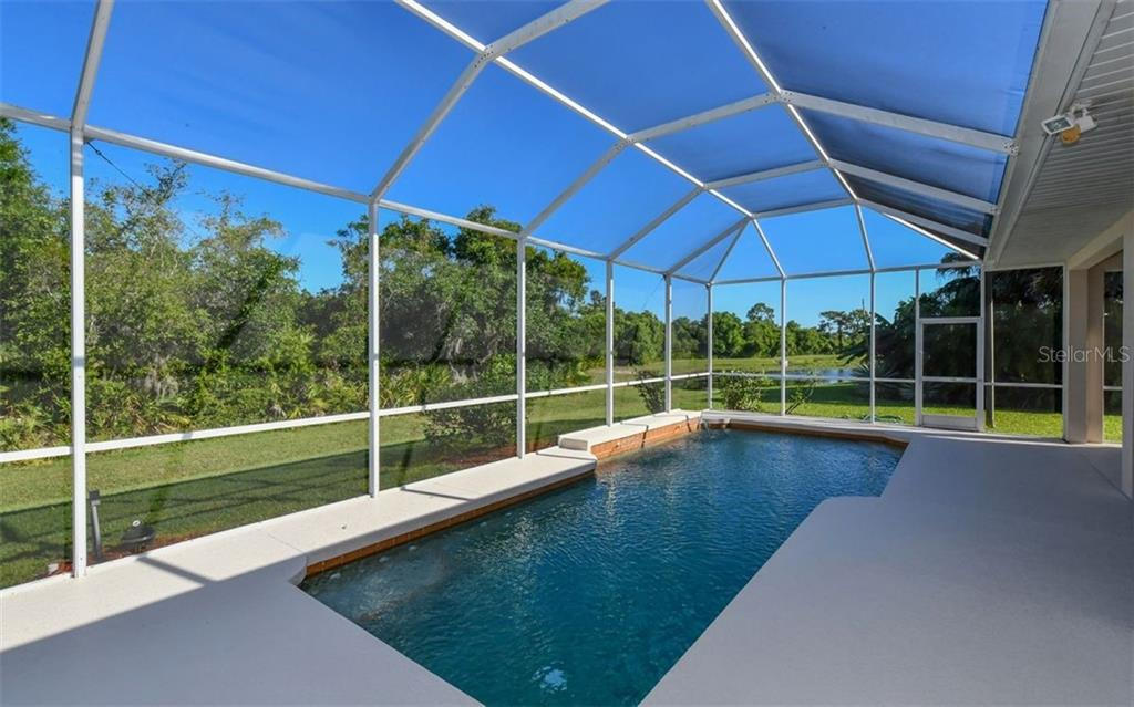 Single Family Home for sale at 6409 Grand Point Ave, University Park, FL 34201 - MLS Number is A4434120