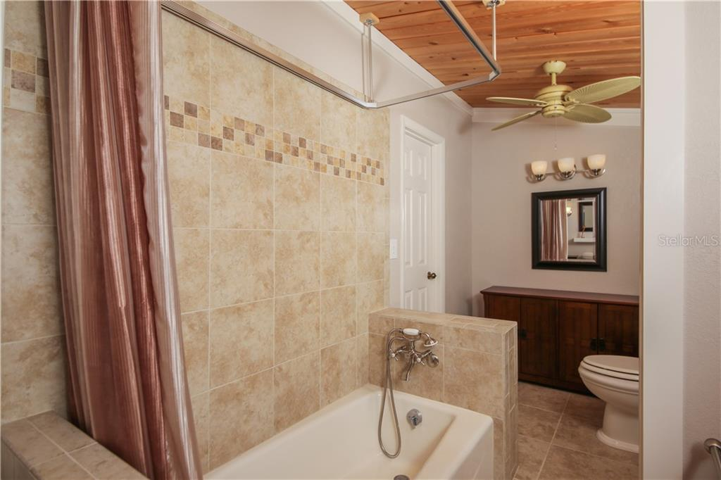 Upstairs bathroom w/tile floor and tongue and groove ceiling - Single Family Home for sale at 7611 Alhambra Dr, Bradenton, FL 34209 - MLS Number is A4434753