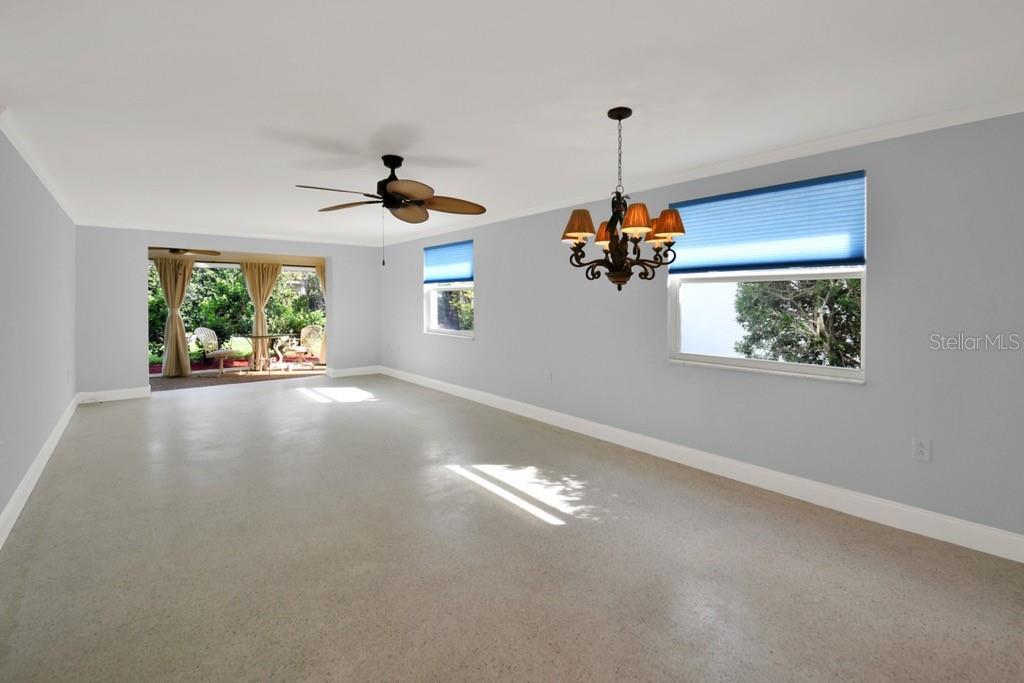 Dining room, Living room, and Lanai. - Villa for sale at 717 Spanish Dr N, Longboat Key, FL 34228 - MLS Number is A4438337