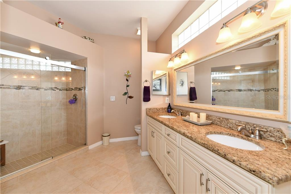 Master Bathroom with new cabinets, sinks, hardware, lights...Gorgeous! - Single Family Home for sale at 4074 Via Mirada, Sarasota, FL 34238 - MLS Number is A4439141