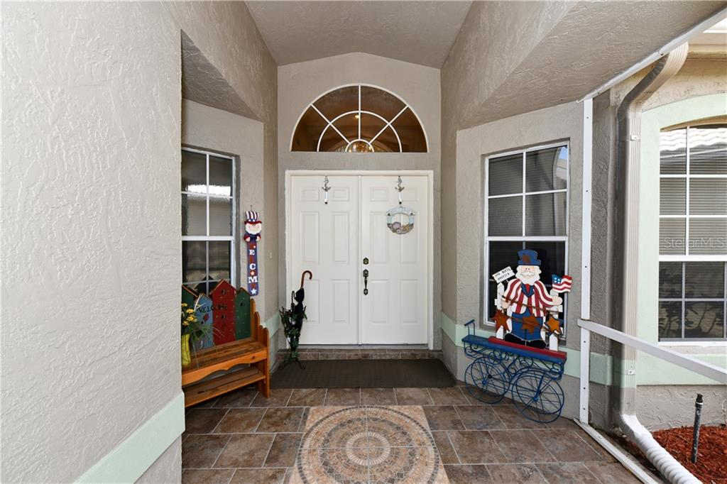 Entry with screened enclosure, tile floors and very inviting!  Enjoy Leaving your front door open for a great cross breeze in the winter months! - Single Family Home for sale at 4074 Via Mirada, Sarasota, FL 34238 - MLS Number is A4439141