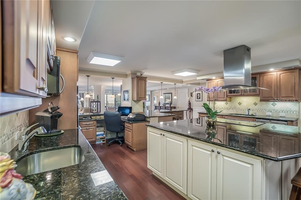 15 / 50Spacious kitchen with desk area - Condo for sale at 20 Whispering Sands Dr #102 & 103, Sarasota, FL 34242 - MLS Number is A4441587