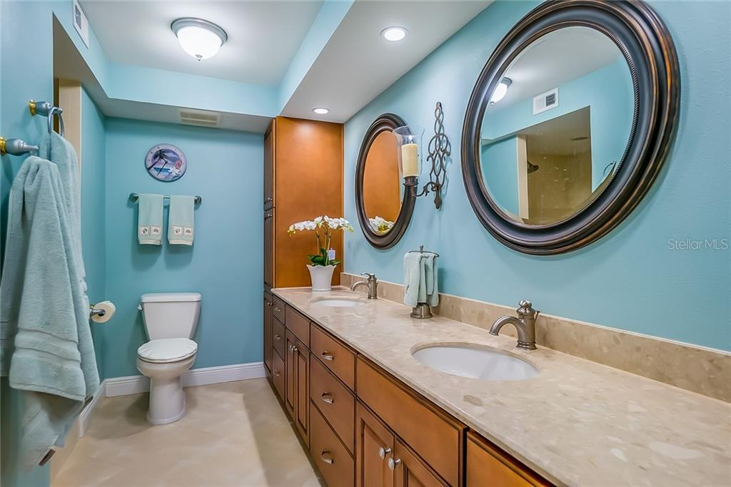 Master Bath #103 with Marble counters, wood cabinets and extra Large shower - Condo for sale at 20 Whispering Sands Dr #102 & 103, Sarasota, FL 34242 - MLS Number is A4441587