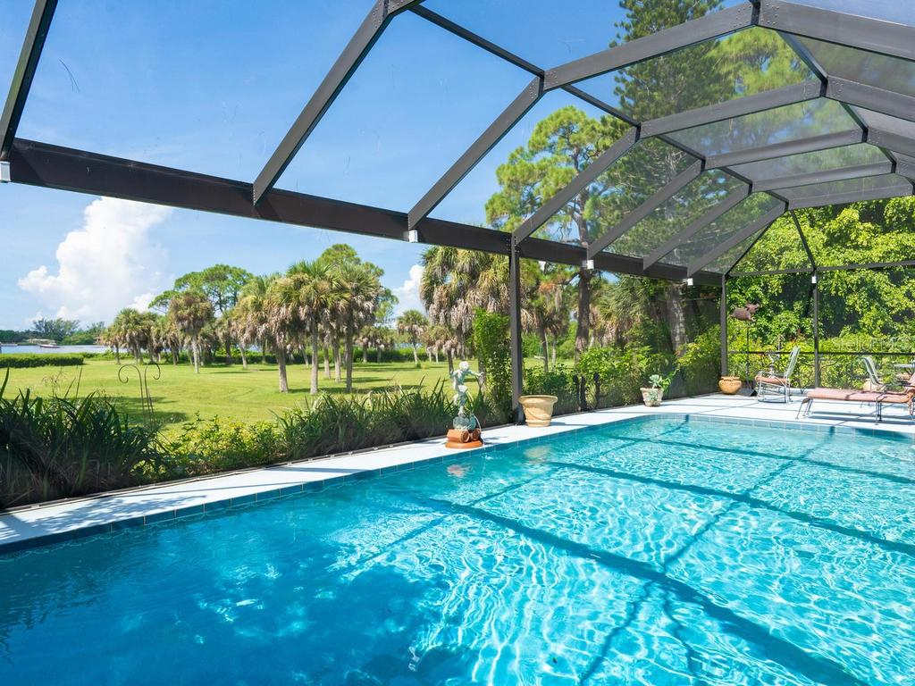 Lush Private Estate - Single Family Home for sale at 1716 Bayshore Dr, Englewood, FL 34223 - MLS Number is A4445961