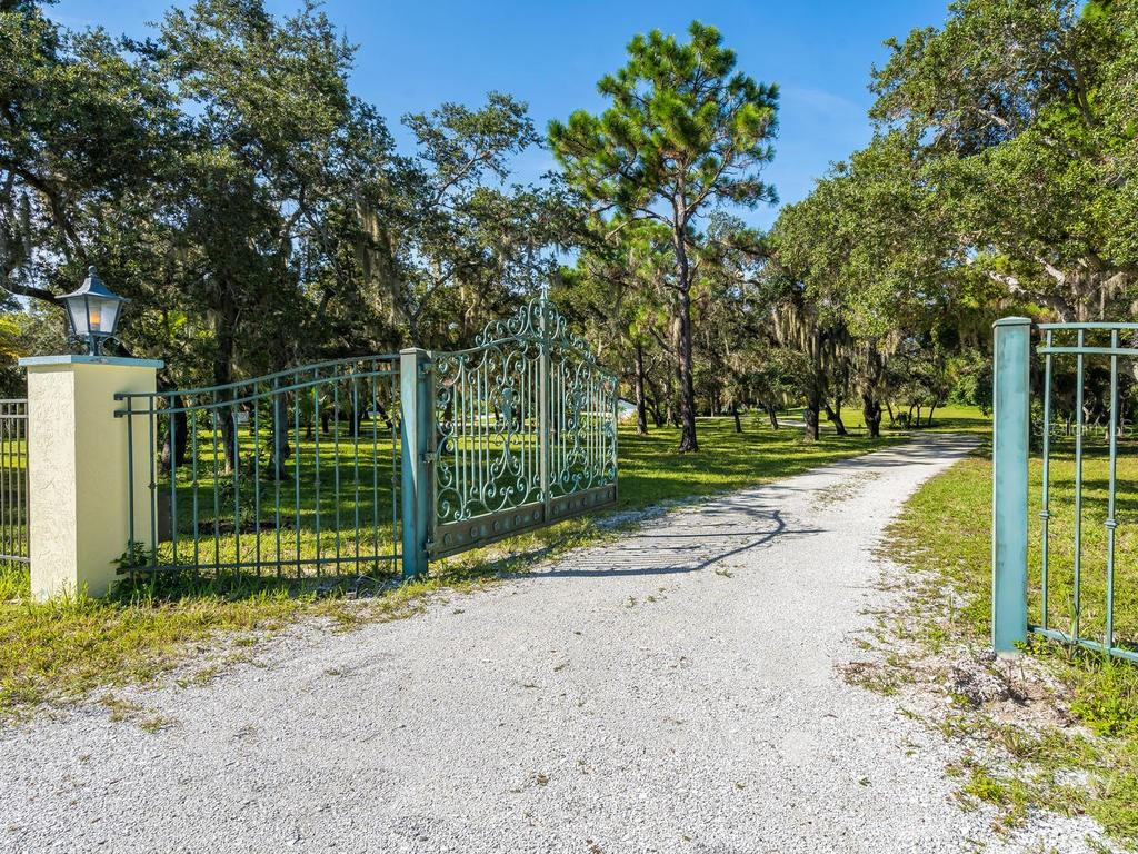 Custom designed gated entry - Single Family Home for sale at 1716 Bayshore Dr, Englewood, FL 34223 - MLS Number is A4445961