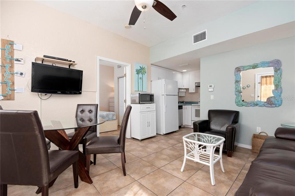 Dancing Bear Living and Kitchen and Dining. - Single Family Home for sale at 523 Beach Rd, Sarasota, FL 34242 - MLS Number is A4446354