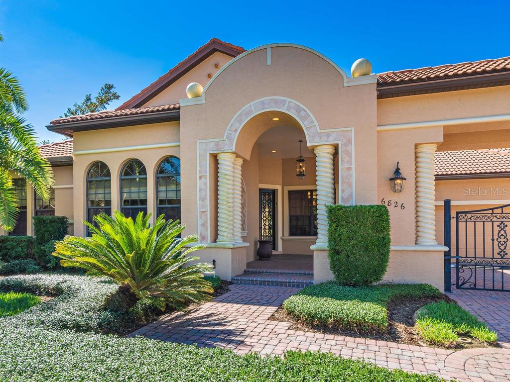 Front entry of home - Single Family Home for sale at 6826 Turnberry Isle Ct, Lakewood Ranch, FL 34202 - MLS Number is A4450601
