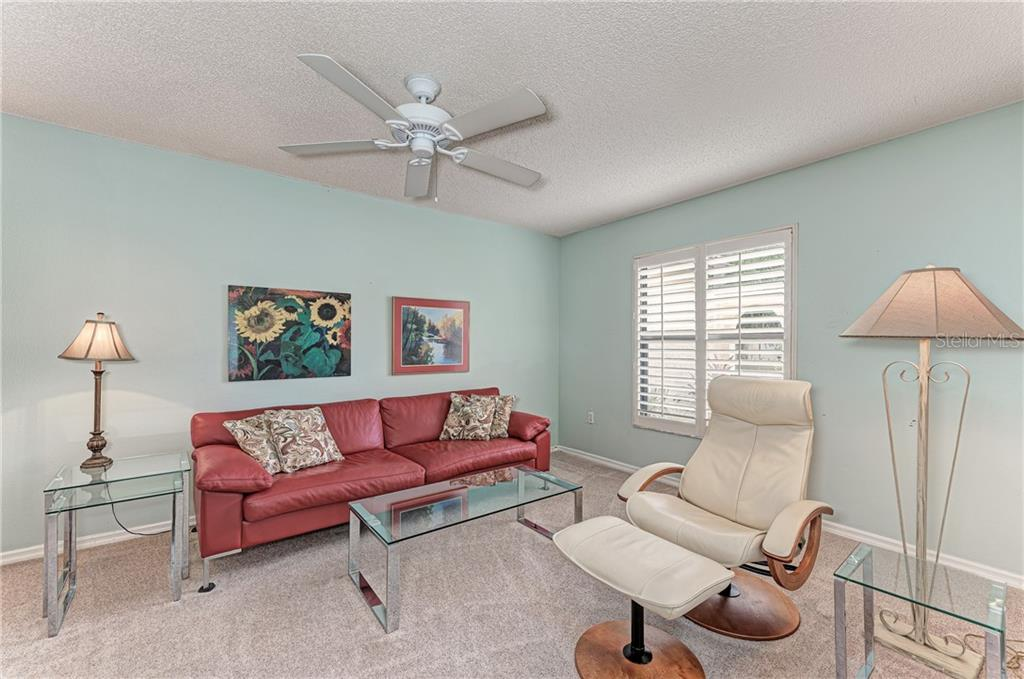 Third bedroom being used as a sitting room - Single Family Home for sale at 2980 Heather Bow, Sarasota, FL 34235 - MLS Number is A4450964