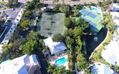 Aerial view of community amenities - Condo for sale at 1260 Dolphin Bay Way #401, Sarasota, FL 34242 - MLS Number is A4173008