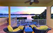 Another gorgeous unobstructed sunset enjoyed from the privacy of the upper master suite on the 2nd level. - Single Family Home for sale at 5824 Tidewood Ave, Sarasota, FL 34231 - MLS Number is A4205461