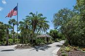 Private gated tree lined entrance - Villa for sale at 7467 Carnoustie Dr #5d, Sarasota, FL 34238 - MLS Number is A4412518