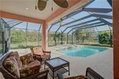 Imagine sitting here and enjoying a cup of tea or coffee and just being mesmerized with the views of the pool/spa and lake. - Single Family Home for sale at 15109 17th Ave E, Bradenton, FL 34212 - MLS Number is A4425963