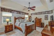 Large master bedroom with tray ceiling - Single Family Home for sale at 6321 W Glen Abbey Ln E, Bradenton, FL 34202 - MLS Number is A4429610