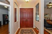 Foyer entry & open to dining - Single Family Home for sale at 2745 Harvest Dr, Sarasota, FL 34240 - MLS Number is A4436381