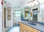 En-suite guest bathroom - Single Family Home for sale at 1716 Bayshore Dr, Englewood, FL 34223 - MLS Number is A4445961