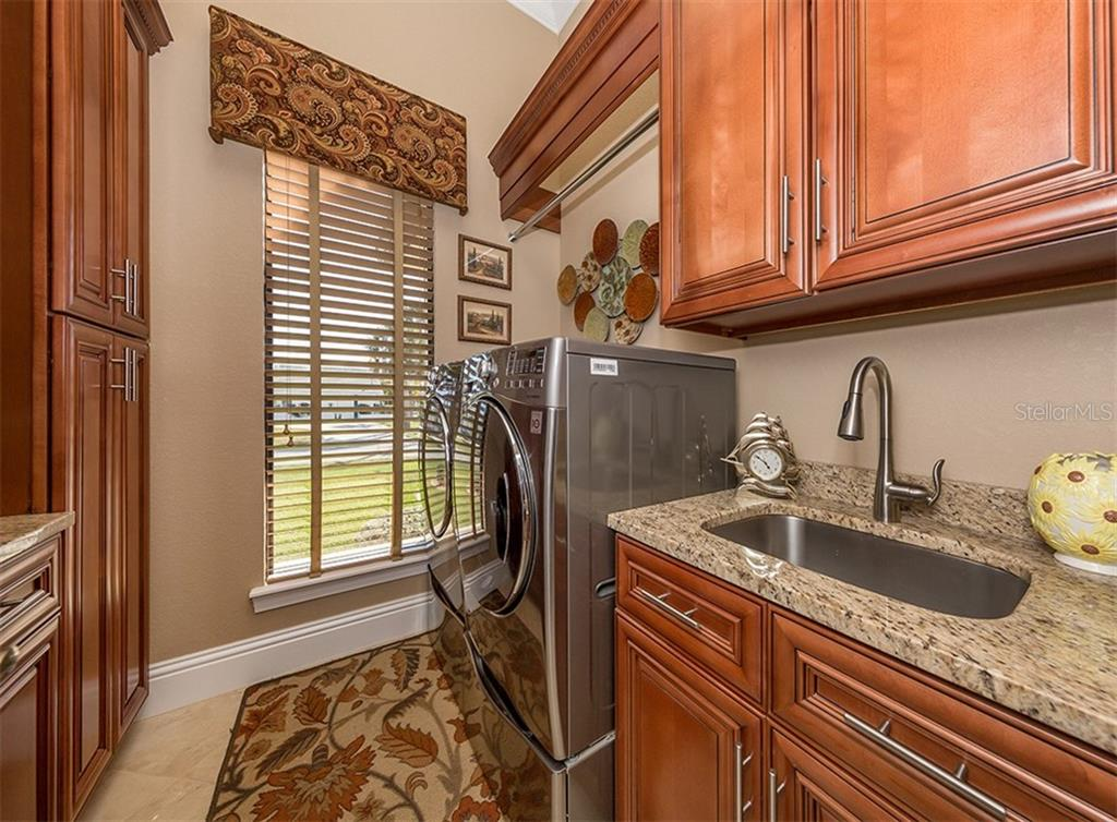 Laundry with built-in cabinetry - Single Family Home for sale at 1980 W Marion Ave, Punta Gorda, FL 33950 - MLS Number is N6104995